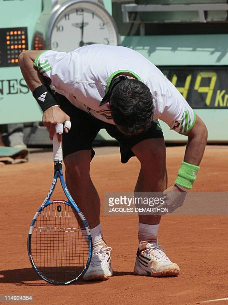 Italia's Fabio Fognini reacts after being wounded as playing with Spain's Albert Montanes during their Men's fourth round match in the French Open...