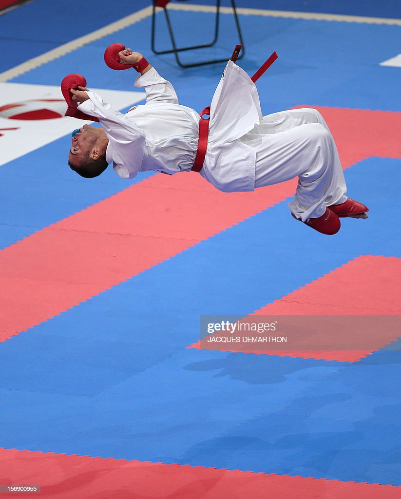 Italiy's Stefano Maniscalco jumps to celebrate his victory over Iran's Zabiollah Poorshab at the end of their men's bronze medal bout in the over 84 kg category at the Karate world championships on November 24, 2012 in Paris.