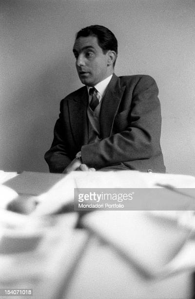 Italo Calvino italian writer and Einaudi publishing company's associate sits at his desk Turin July 1959