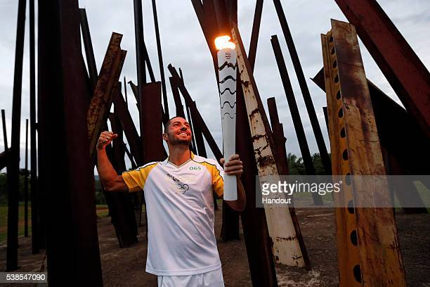 Italo Manzine with Olympic Torch at Inhotim Institute on day 11 during the Olympic Flame torch relay on May 13 2016 in Brumadinho Brazil The Olympic...