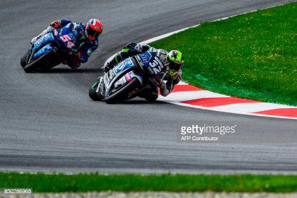 Italtrans Racing's Team Italian rider Mattia Pasini and BEAVIP SAG Team's Spanish rider Isaac Vinales compete during first practice session of the...