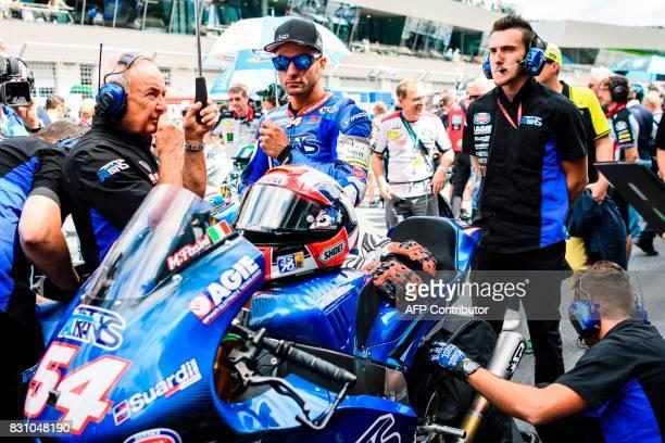 Italtrans Racing's Team Italian rider Mattia Pasini prepares on grid for the start of the Moto2 Austrian Grand Prix race at Red Bull Ring in...