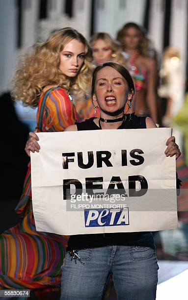 A PETA activist holds a banner 'Fur is dead' during Roberto Cavalli's Spring/Summer 2006 women's collections 30 September 2005 in Milan AFP PHOTO /...