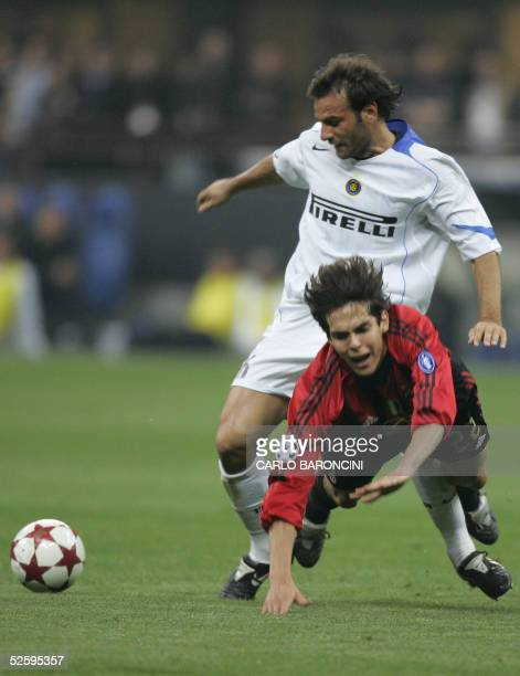 AC Milan's Brazilian midfielder Kaka is fouled by Inter Milan's Argentinian defender Cristiano Zanetti during their Champions League football match...