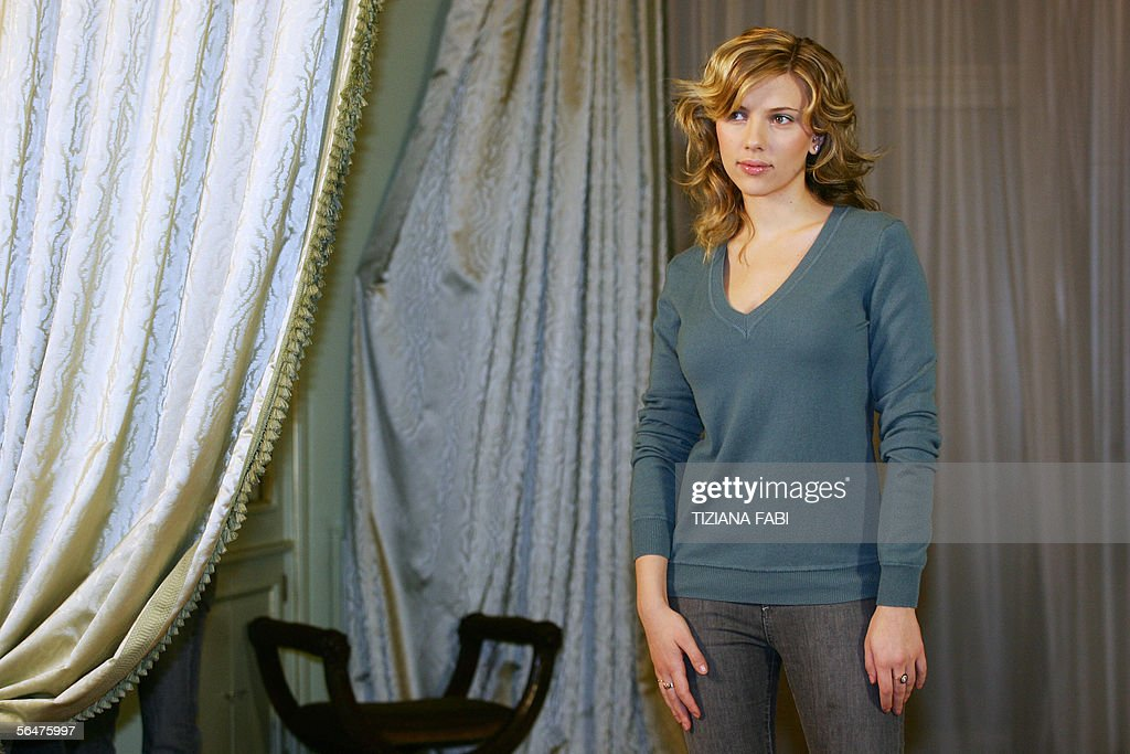 Actress Scarlett Johansson of US poses with their during a photocall of 'Match Point' directed by US Woody Allen, in Rome 21 December 2005.