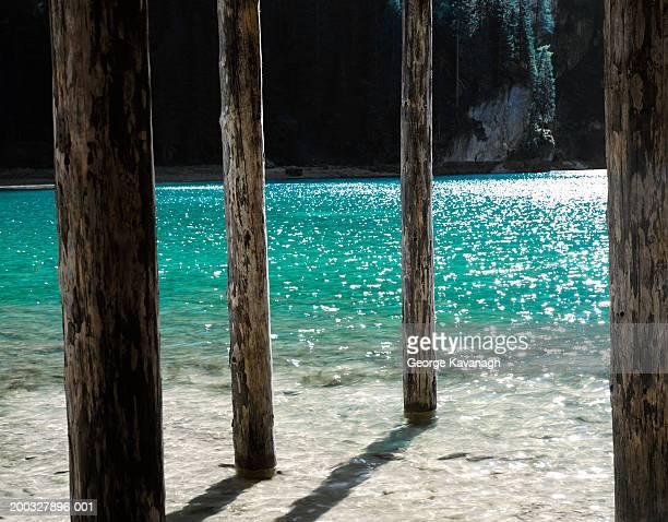 Italy, Alto Adige, Dolomites, Lake Braies, jetty poles