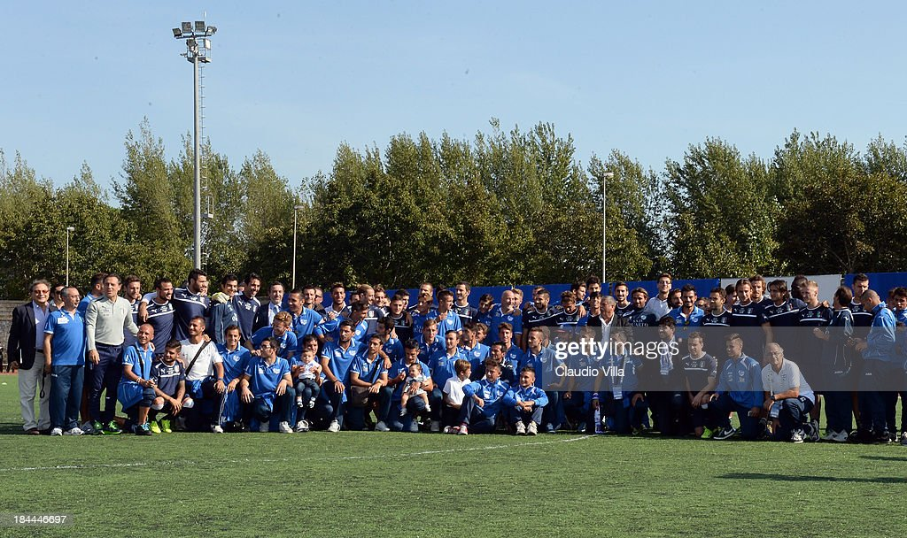 Italy and Quarto players pose for a photo ahead a Italy training session on October 14, 2013 in Naples, Italy. The training session was organised at Quarto, a football pitch built on land confiscated from the Camorra - the Neapolitan Mafia, as part of the fight against the mafia.