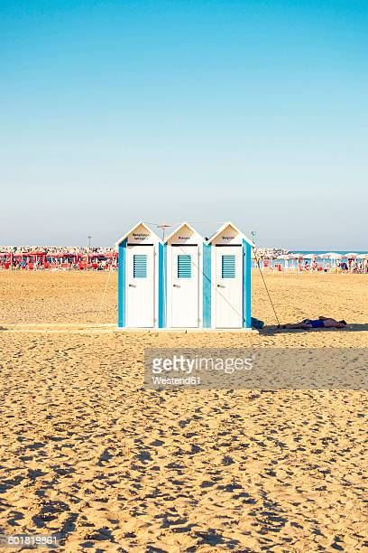 Italy, Apulia, Gargano, cabins on the beach of Rodi Garganico