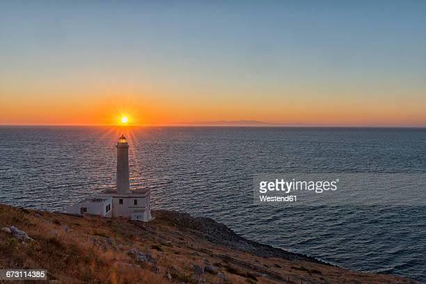 Italy, Apulia, Salento, Capo dOtranto, Sunrise over lighthouse