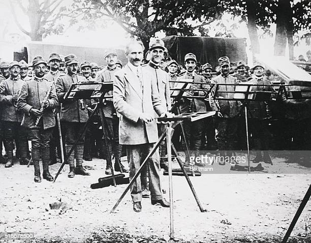 Arturo Toscanini leads a band near the fighting front in World War I in Italy