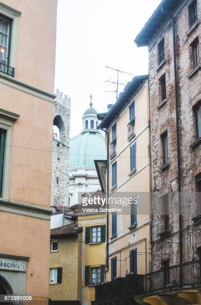 Italy, Brescia, a street and cuppola of New Cathedral