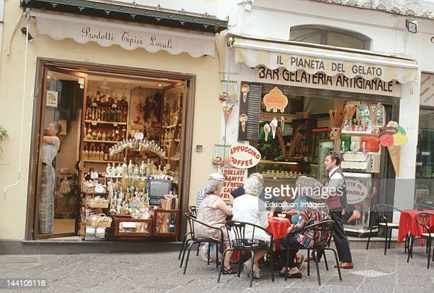 Italy Campania Salerno Bay Piazza Del Duomo Amalfi Group Of Elderly People Sit At Outdoor Cafe