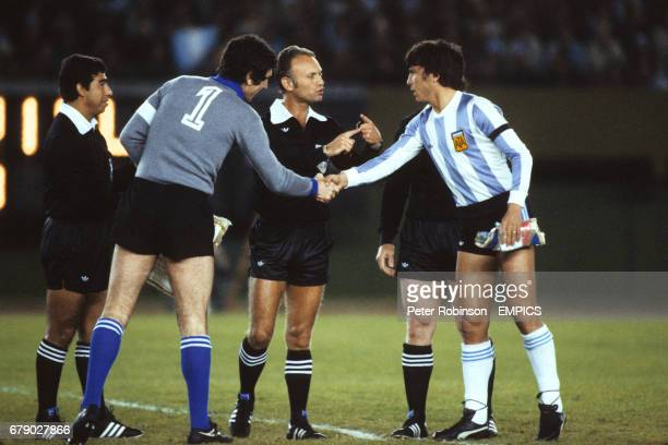 Italy captain Dino Zoff shakes hands with Argentina captain Daniel Passarella in front of Referee Abraham Klein