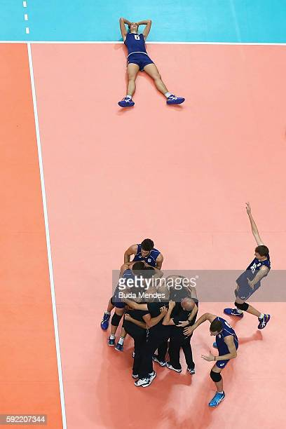 Italy celebrate victory over the United States during the Men's Volleyball Semifinal match on Day 14 of the Rio 2016 Olympic Games at the...