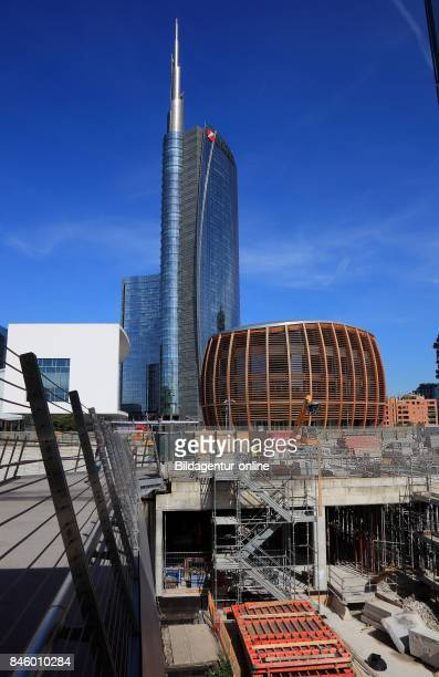 Italy City of Milan Porta Nuova Bank of Unicredit Bank and Pavilion Auditorium at Piazza Gae Aulenti and Before It Large Building Site