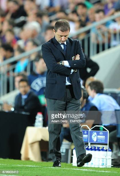 Italy coach Devis Mangia dejected on the touchline