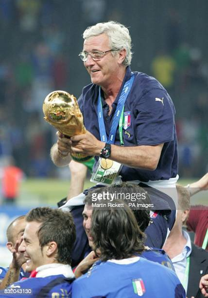 Italy coach Marcelo Lippi celebrates with the trophy