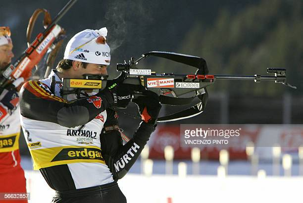 CORRECTION RACE German Ricco Gross shoots over Halvard Hanevold of Norway during the men's 12 km pursuit race of the Biathlon World Cup in Anterselva...