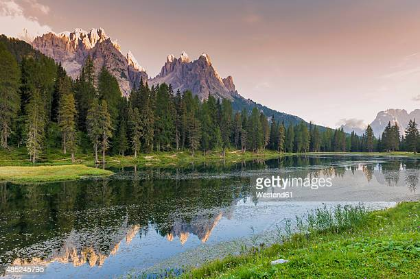 Italy, Dolomite Alps, mountains and lake by evening twilight