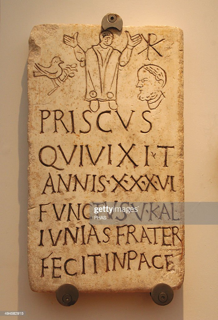 Italy Early Christians Roman funerary stele of Prisco Inscription Christian phrase appears 'in pace' The symbol of the dove and the olive branch and...