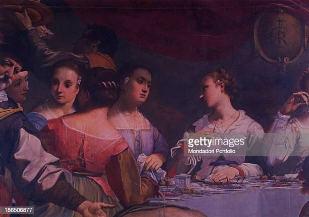 Italy Emilia Romagna Ferrara National Gallery Detail A group of people sitting at a table with plates full of fruit dressed with typical dresses of...