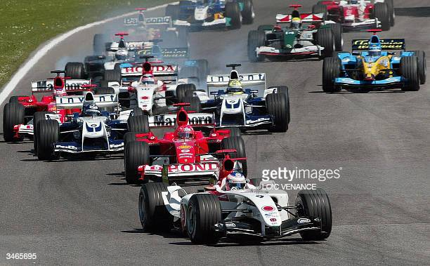English BARHonda driver Jenson Button leads the pack after the start of the San Marino Grand Prix 25 April 2004 in Imola Italy AFP PHOTO LOIC VENANCE