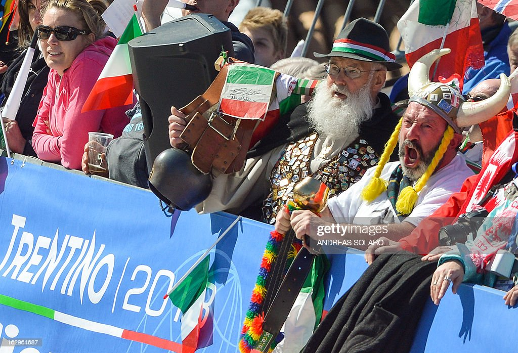 Italy fans cheer on March 2, 2013 during the Women's Cross Country 30 km Classic race of the FIS Nordic World Ski Championships at Val Di Fiemme Cross Country stadium in Cavalese, northern Italy. AFP PHOTO / ANDREAS SOLARO