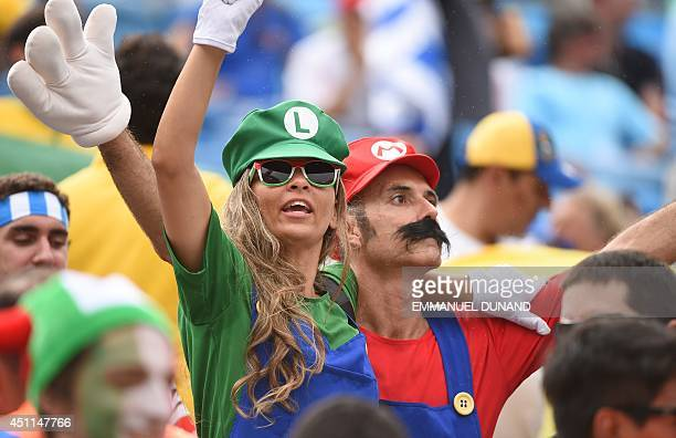 Italy fans show their support for Italy's forward Mario Balotelli by dressing up as Super Mario and Luigi prior to the Group D football match between...
