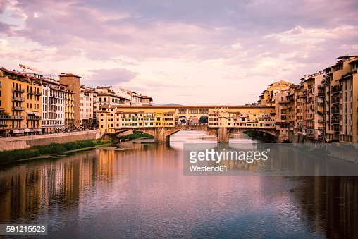 Italy, Florence, River Arno and Ponte Vecchio at sunset