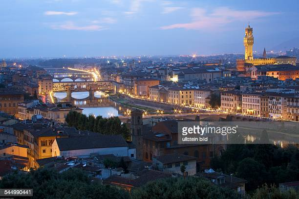 Italy Florenz Firenze Florence View upon the city in the night Arno River right handed the City hall Plazzo Veccioo