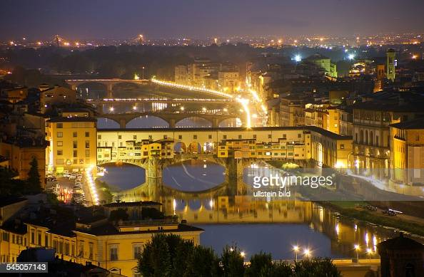 Italy Florenz Firenze Florence View upon the city in the night Ponte Veccio Bridge above the Arno River