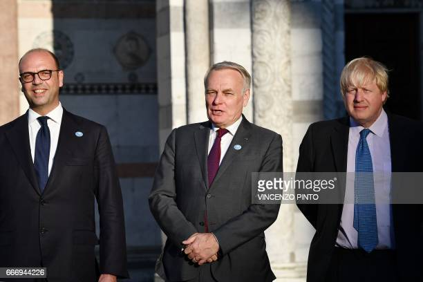 Italy Foreign Minister Angelino Alfano French Foreign Minister JeanMarc Ayrault and British Foreign Secretary Boris Johnson arrive for a family...