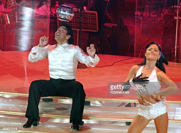 Former soccer star Argentinian Diego Maradona dances with Italian dancer Angela Panico during the TV show 'Ballando con le stelle' 01 October 2005 in...