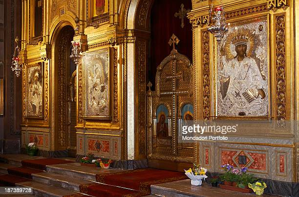 Italy FriuliVenezia Giulia Trieste Chiesa di San Spiridione Detail The iconostasis made of engraved golden wood with the icon of Jesus Christ made of...