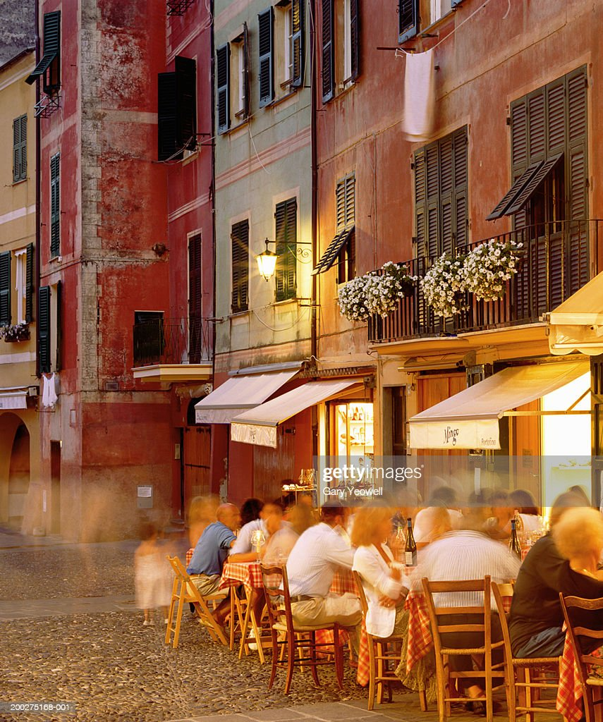 Italy, Genoa, Portofino, diners outside restaurant (long exposure)