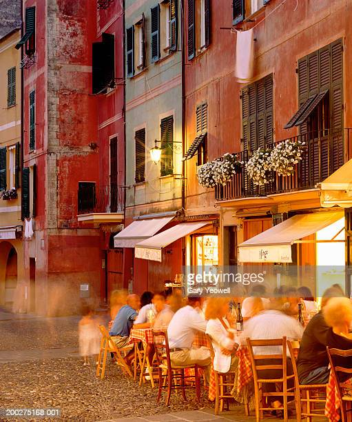 Italy, Genoa, Portofino, diners outside restaurant (long exposure)