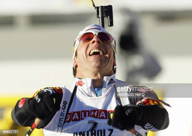 German Ricco Gross celebrates as he crosses the finish line of the Women's 75 km pursuit race of the Biathlon World Cup in Anterselva 20 January 2006...