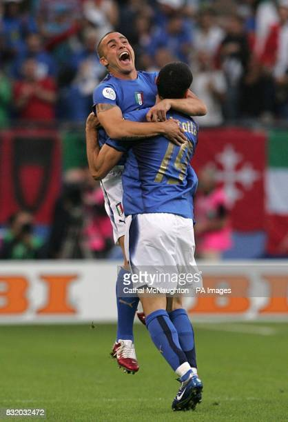 Italy goal scorer Gianluca Zambrotta is congratulated by Fabio Cannavaro