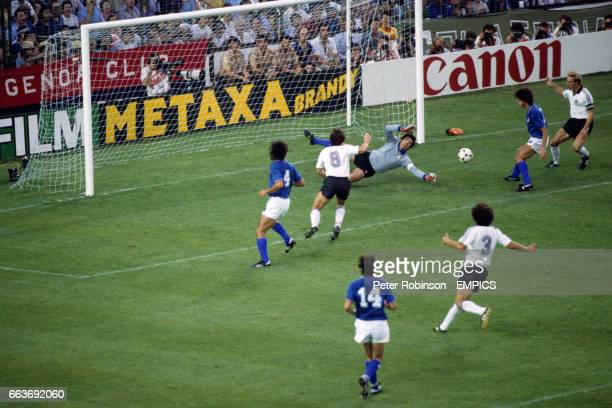 Italy goalkeeper Dino Zoff saves at the feet of West Germany's KarlHeinz Rummenigge and Klaus Fischer