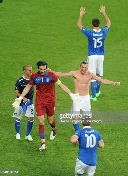 Italy goalkeeper Gianluigi Buffon and Antonio Cassano celebrate with their team mates after the final whistle