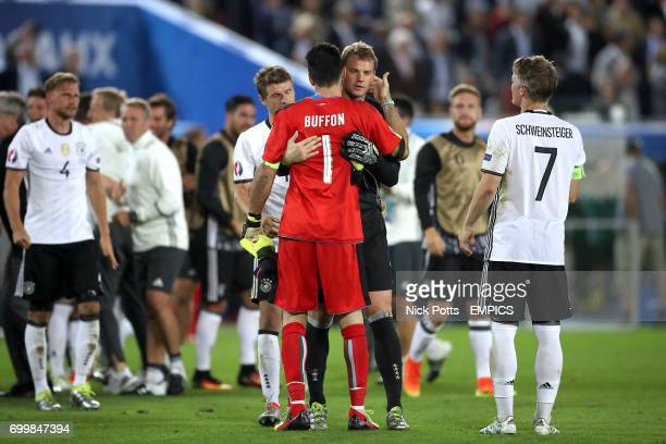 Italy goalkeeper Gianluigi Buffon and Germany goalkeeper Manuel Neuer embrace after the game