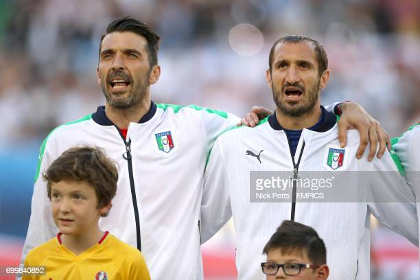 Italy goalkeeper Gianluigi Buffon and Italy's Giorgio Chiellini sing the national anthem before the game