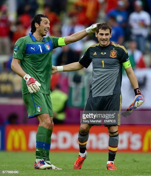 Italy goalkeeper Gianluigi Buffon and Spain goalkeeper Iker Casillas congratulate each other after the game