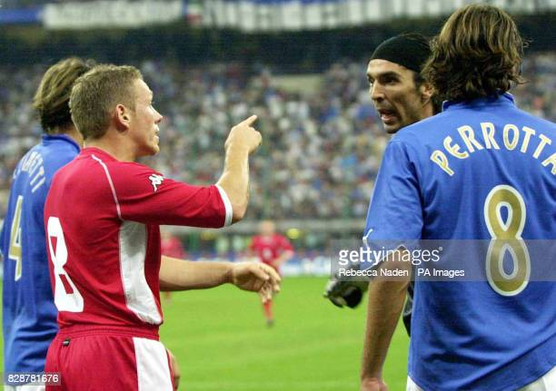 Italy goalkeeper Gianluigi Buffon argues with Wales' Craig Bellamy who received a yellow card over the incident during their group nine Euro 2004...