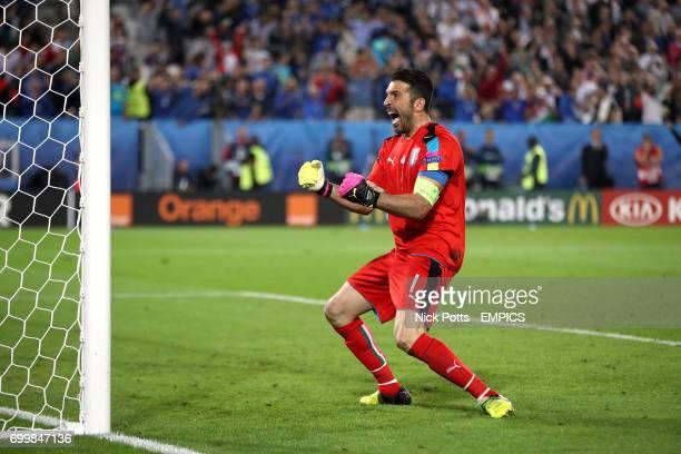 Italy goalkeeper Gianluigi Buffon celebrates saving a penalty in the shootout from Germany's Thomas Muller