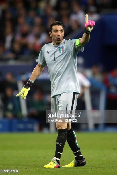 Italy goalkeeper Gianluigi Buffon gestures to supporters