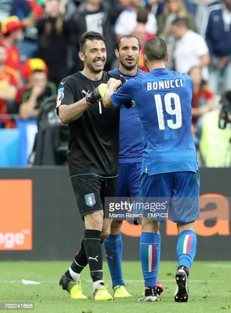 Italy goalkeeper Gianluigi Buffon Giorgio Chiellini and Leonardo Bonucci celebrate victory after the final whistle