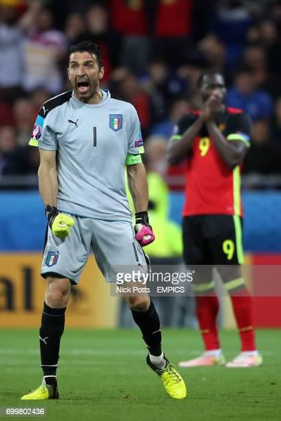 Italy goalkeeper Gianluigi Buffon reacts as Belgium's Romelu Lukaku rues a missed chance to score