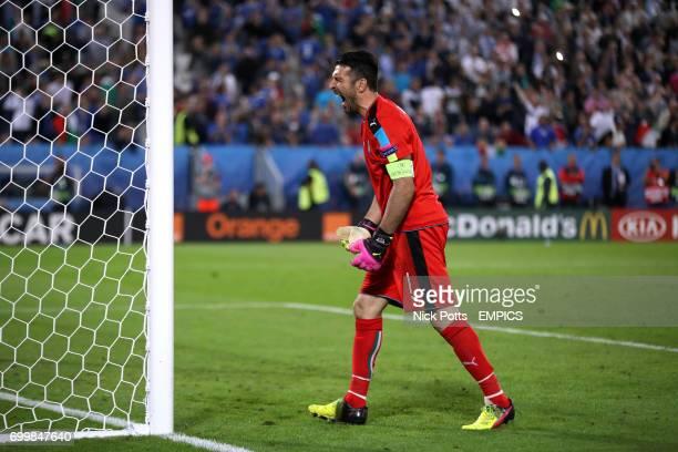 Italy goalkeeper Gianluigi Buffon reacts during the penalty shootout