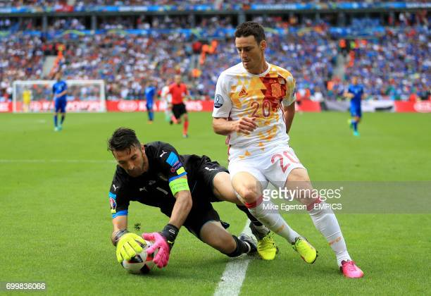 Italy goalkeeper Gianluigi Buffon saves from Spain's Aritz Aduriz